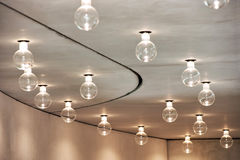 Lightbulbs Arranged in Pattern in Room Ceiling Royalty Free Stock Photo