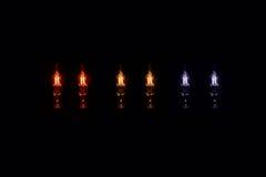 Lightbulbs. Colored lightbulbs on black background Stock Photo