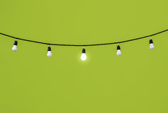 Lightbulbs on green Royalty Free Stock Image