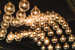 Lightbulbs or lamps decorated on the ceiling, dimmed light tone, vintage interior concept Stock Images