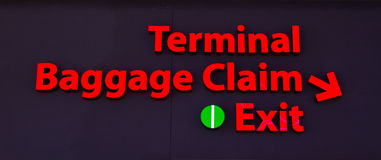 Lighted Baggage Claim Airport Sign. A lighted airport terminal and baggage claim sign Royalty Free Stock Image