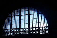 Lighted Arched Windows. Bluish lighted arched windows with ornate design royalty free stock images