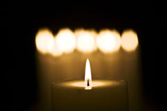 Lighted aromatic table candle Royalty Free Stock Photography