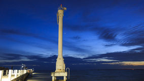 Lighted Beacon or Leading Light with Sunsets and Clouds at bang pu seaside, Samutprakarn, Thailand.  Stock Photography