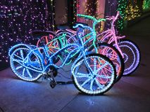 Lighted bikes. Bright lit up bikes on a sidewalk Stock Images
