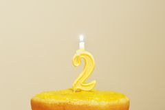 Lighted birthday candle Stock Image