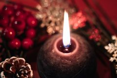 Lighted Black Round Candle Stock Image