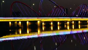 Lighted bridge night view in Nanning city China. Xingxvjiang bridge night view in Nanning city China stock video footage