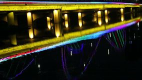 Lighted bridge reflection on river night view. Xingxvjiang bridge reflection on river night view in Nanning city China stock footage