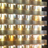 Lighted apartment block facade Stock Photography