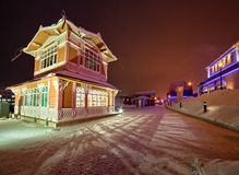 Lighted buildings at night. Exterior of lighted buildings on a snowy, wintry night Stock Photo