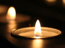 Lighted candle. Candle lights taken with macro lense Royalty Free Stock Photo