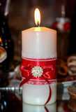 Lighted candle at wedding Stock Photography