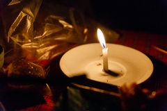 Lighted Candle in White Plate with Mosquito Royalty Free Stock Images