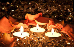 Lighted candles Stock Photos