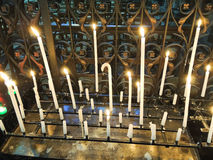 Lighted candles on altar of cathedral Royalty Free Stock Photo
