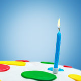 Lighted candles on a birthday cake Royalty Free Stock Photos