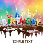 Lighted candles on a birthday cake Royalty Free Stock Photography