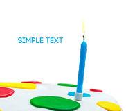 Lighted candles on a birthday cake isolated Royalty Free Stock Photos