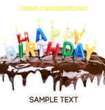 Lighted candles on a birthday cake isolated Stock Image