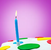 Lighted candles on a birthday cake Stock Image