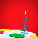 Lighted candles on a birthday cake Stock Photos
