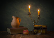 Lighted candles and books Stock Image