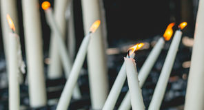 Lighted candles in the chapel of Lourdes Royalty Free Stock Images