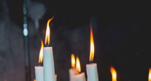 Lighted candles in the chapel of Lourdes Stock Photography