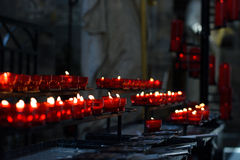 Lighted candles in a church Stock Photos