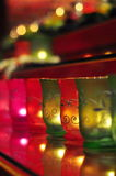 Lighted candles in colorful glass Royalty Free Stock Images