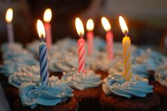 Lighted Candles on Cupcakes Royalty Free Stock Images