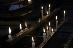 Lighted candles in the dark royalty free stock images