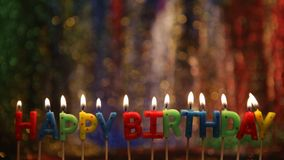 Happy birthday candles. Lighted candles in the form of letters a happy birthday stock footage