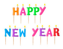 Lighted candles happy new year Royalty Free Stock Photos