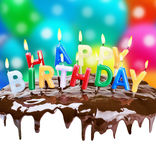 Lighted candles on his birthday on a birthday cake Royalty Free Stock Images