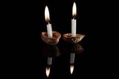 Lighted candles in nutshells Royalty Free Stock Photo