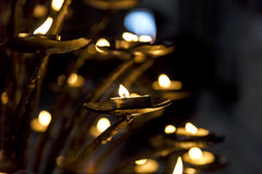 Lighted candles in one of the temples. Object Stock Photos