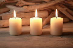 Lighted candles. Photography of Lighted candles on wood background Royalty Free Stock Photo