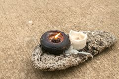 Lighted candles on piece of dried wood Royalty Free Stock Photography