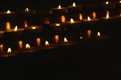 Lighted candles for ritual execution. Dark room stock photography