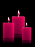 Lighted Christmas Candles Stock Images