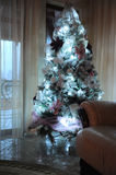 Lighted christmas tree in home Royalty Free Stock Image