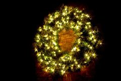 Lighted Christmas Wreath at night royalty free stock image