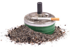 Lighted cigarette with a filter on the ashtray and ashes Royalty Free Stock Image