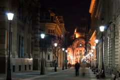 Lighted city alley. Evening lights on an European city alley stock photo
