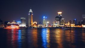 Lighted City Skyline Near Body of Water during Nighttime Royalty Free Stock Photo