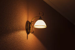 Lighted classic lamp on the wall Stock Image