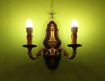 Lighted classic lamp on the wall Royalty Free Stock Images