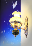 Lighted classic sconce on the wall Royalty Free Stock Photo